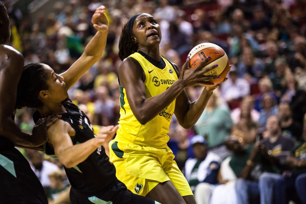 Crystal Langhorne attempts a shot over New York Liberty on Aug. 17. (Rebekah Welch / The Seattle Times)