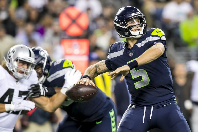 Seahawks quarterback Alex McGough throws in the third quarter as the Seattle Seahawks take on the Oakland Raiders at CenturyLink Field in Seattle on Thursday, August 30, for their final preseason game. (Bettina Hansen / The Seattle Times)