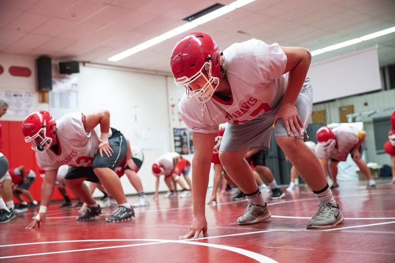 Marysville-Pilchuck offensive lineman Cade Tucker, right, is expected to lead the Tomahawks' line. (Dean Rutz / The Seattle Times)