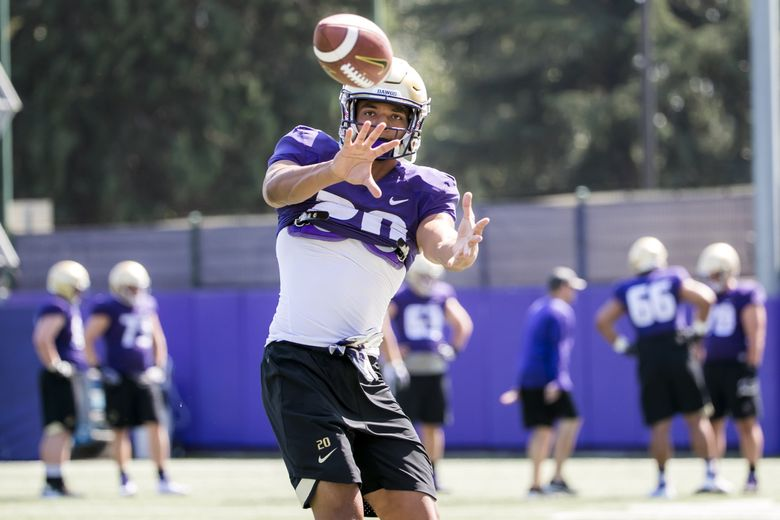 Wide receiver Ty Jones makes a catch during fall training camp at Husky Stadium at the University of Washington Sunday August 5. (Bettina Hansen / The Seattle Times)