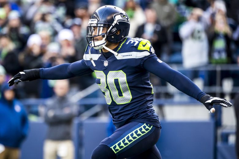 SEAHAWKS FILE —Seahawks defensive back Bradley McDougald comes out flying for introductions before the Seattle Seahawks take on the Arizona Cardinals at CenturyLink Field in Seattle, Sunday December 31, 2017. 204716 (Bettina Hansen / The Seattle Times)