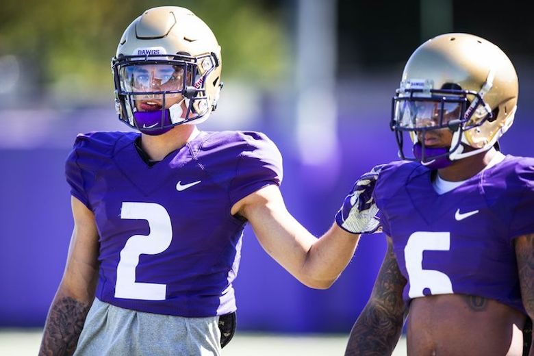 Washington junior receiver Aaron Fuller (2) with teammate Chico McClatcher (6) during a practice drill Tuesday, August 7, 2018. (Dean Rutz/The Seattle Times)