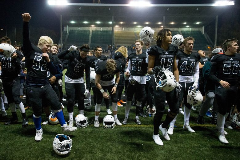 Eastside Catholic celebrates after beating Edmonds-Woodway in the playoffs last season. (Courtney Pedroza / The Seattle Times)