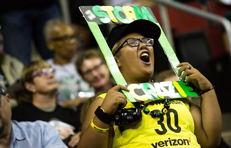 A Storm fan cheers with a homemade sign during the game at Key Arena, August 19, 2018. Storm beat the Wings 84-68. 207402 (Rebekah Welch / The Seattle Times)