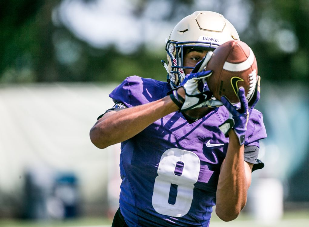 Wide receiver Marquis Spiker runs a drill during football practice at Husky Stadium, on August 6, 2018. (Rebekah Welch/The Seattle Times)