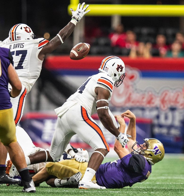 Jake Browning misses the last opportunity to give the Huskies a chance to win as Auburn's Dontavius Russell gets to him in the backfield and forces an incomplete pass. (Dean Rutz / The Seattle Times)