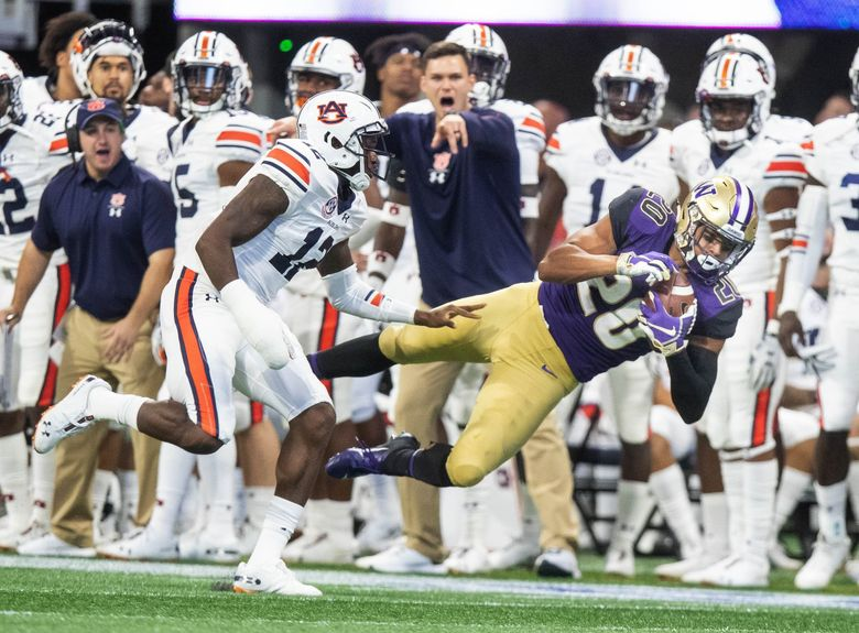 Washington receiver Ty Jones pulls in a first down reception to the Auburn 27 yard line in the third quarter.  (Dean Rutz / The Seattle Times)