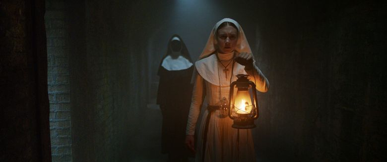 """A novitiate (Taissa Farmiga, right) discovers demonic doings afoot in """"The Nun."""" (Courtesy of Warner Bros. Pictures)"""
