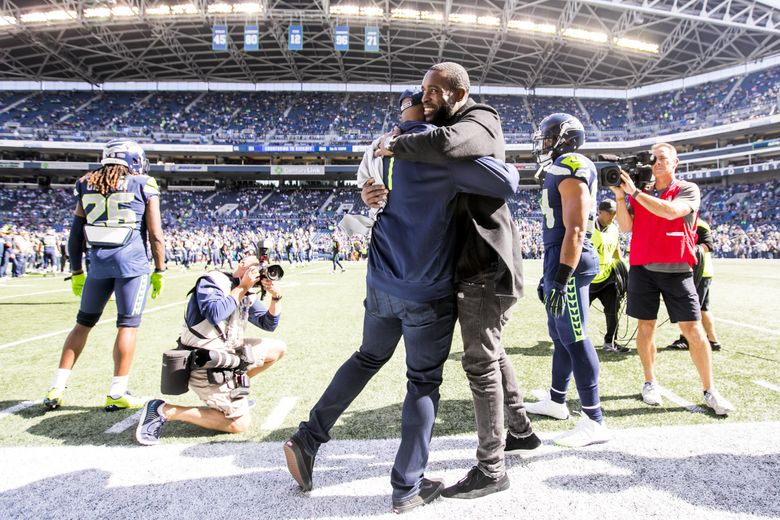 Seahawks defensive back Kam Chancellor walks the sidelines before raising the 12th Man flag before the Seattle Seahawks take on the Dallas Cowboys for their home opener at CenturyLink Field in Seattle Sunday September 23, 2018. (Bettina Hansen / The Seattle Times)