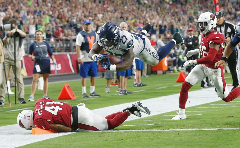 Mike Davis scores a touchdown in the first quarter as the Seattle Seahawks take on the Arizona Cardinals at State Farm Stadium in Glendale, Arizona Sunday September 30, 2018. (Bettina Hansen / The Seattle Times)