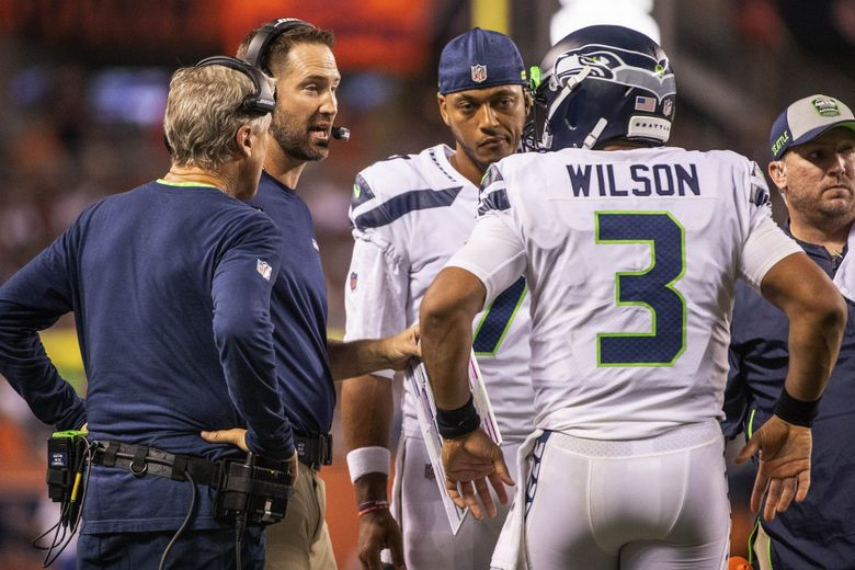 On 3rd and 10 on their own 8-yard line, Seattle calls a timeout for Russell Wilson to confer with offensive coordinator Brian Schottenheimer. (Dean Rutz / The Seattle Times)