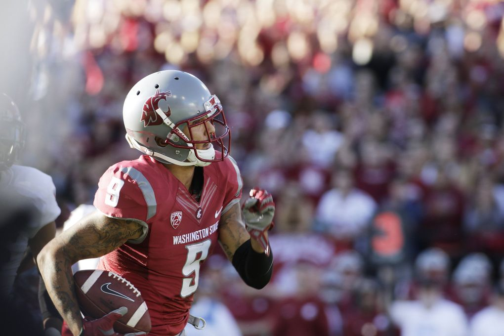 Washington State wide receiver Gabe Marks (9) runs with the ball during the first half. (Young Kwak / AP)