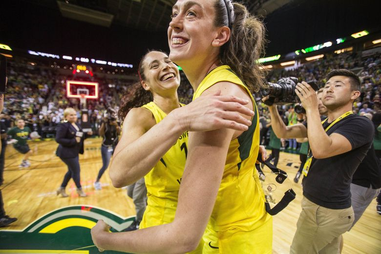 Sue Bird and Breanna Stewart celebrate the Storm's 94-84 come-from-behind win over Phoenix in Game 5 of the WNBA Semifinals. (Dean Rutz / The Seattle Times)