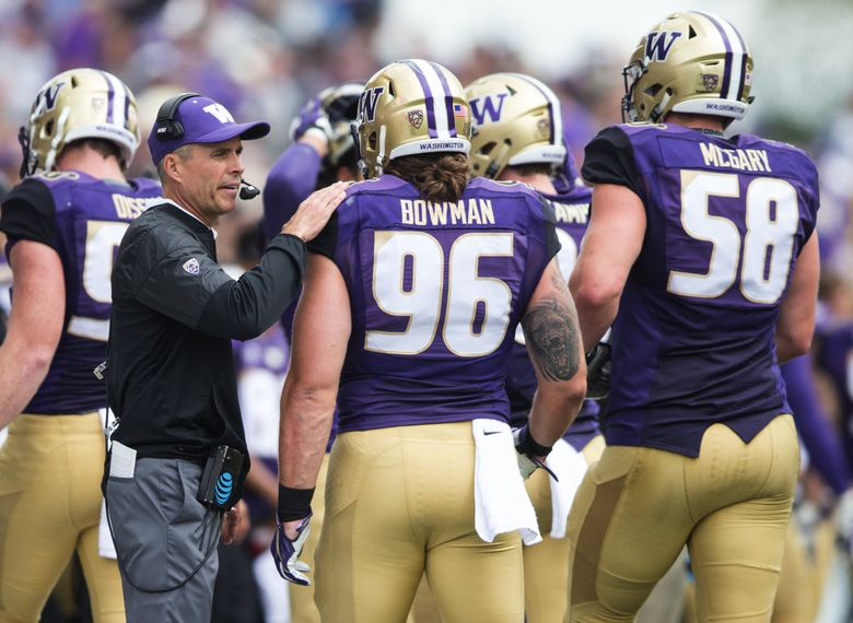 Huskies coach Chris Petersen greets some of his players, including Washington defensive lineman Shane Bowman.   (Lindsey Wasson / The Seattle Times)