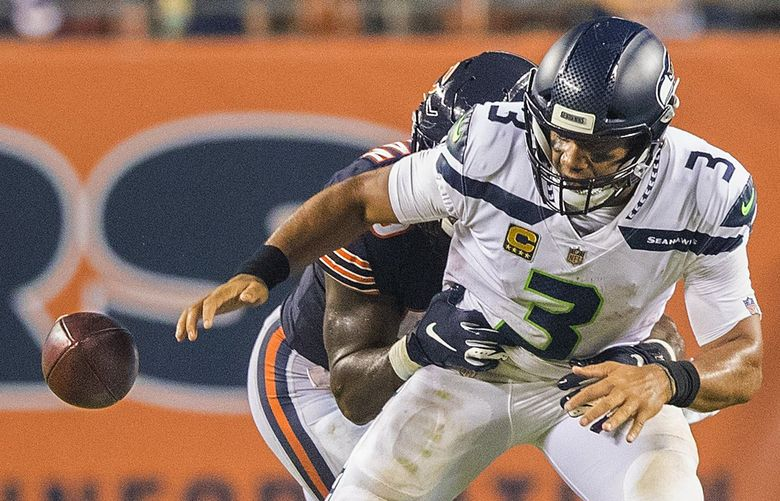Seattle Seahawks quarterback Russell Wilson (3) fumbles and loses the ball during 4th quarter action as the Chicago Bears play the Seattle Seahawks at Soldier Field in Chicago on September 17, 2018. 207697 (Mike Siegel / The Seattle Times)