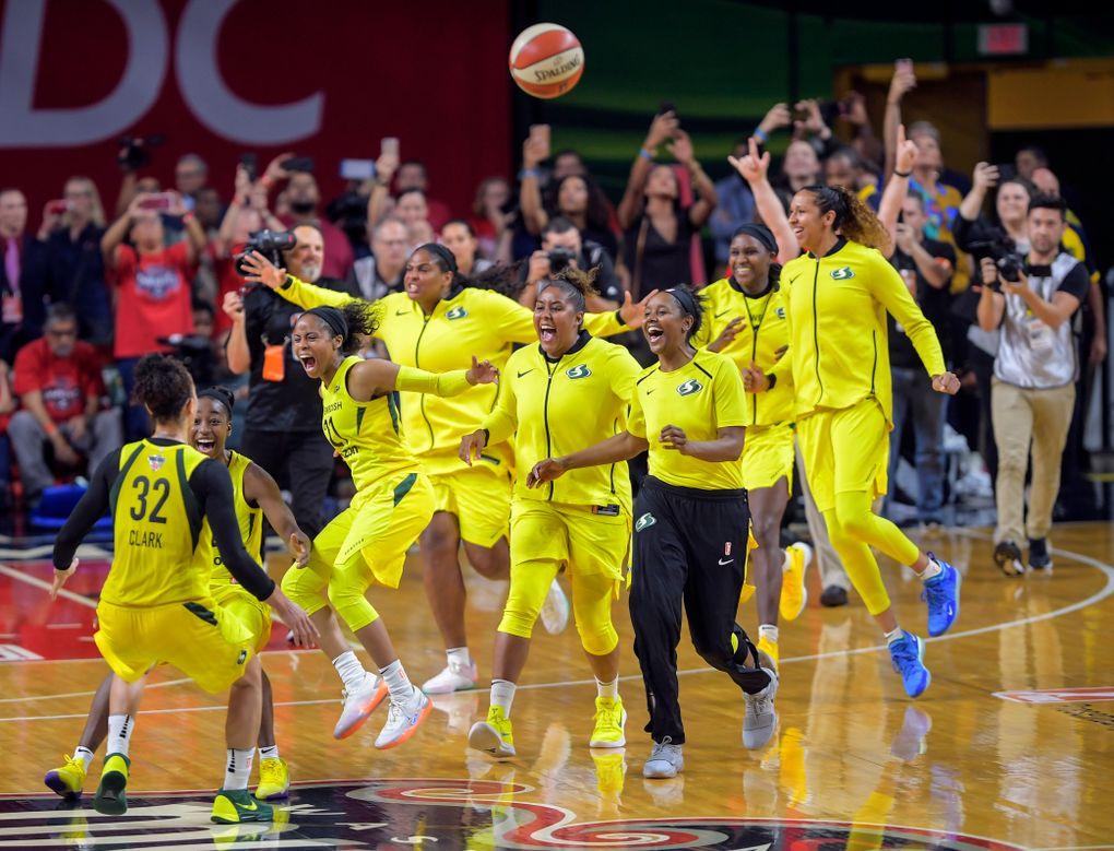 The Seattle Storm celebrate after sweeping the Washington Mystics for the franchise's third WNBA Finals title. (Washington Post photo by John McDonnell).