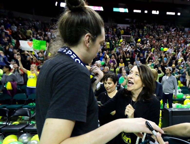 In this photo taken Sunday, Sept. 16 2018, Sen. Maria Cantwell, D-Wash., right, greets Seattle Storm forward Breanna Stewart, left, during a fan rally in Seattle to celebrate the Storm winning the 2018 WNBA basketball championship. Cantwell has easily won re-election to the U.S. Senate in previous years, but as she seeks her fourth-term this November, she is facing her most recognizable opponent — Republican Susan Hutchison, who spent two decades as a Seattle TV news anchor before leading the state Republican party for five years. (AP Photo/Ted S. Warren)