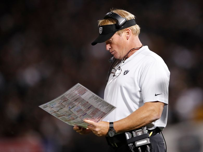 FILE – In this Sept. 10, 2018, file photo, Oakland Raiders coach Jon Gruden looks at at charts during the second half of the team's NFL football game against the Los Angeles Rams in Oakland, Calif. The winless Raiders play the Miami Dolphins, who have won twice, this week. (AP Photo/John Hefti)
