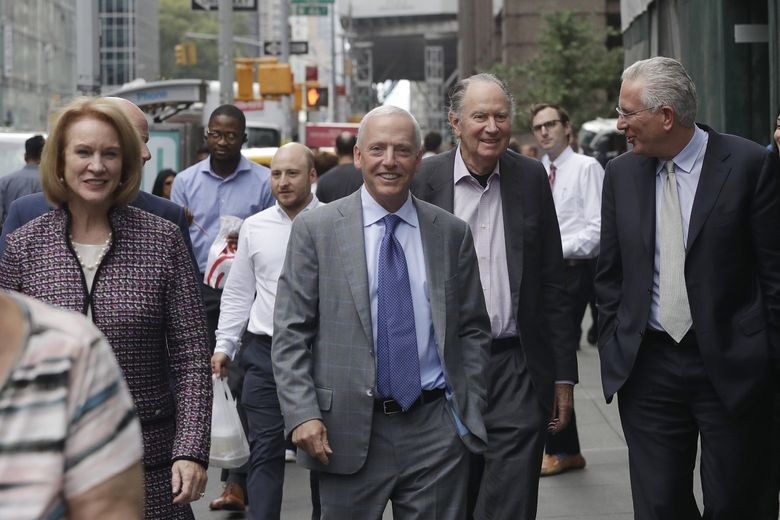 A Seattle delegation of minority owner David Wright, Seattle Mayor Jenny Durkan, minority owner Len Potter, managing partner David Bonderman and NHL Seattle head Tod Leiweke (L to R), leave a Tuesday morning meeting with the NHL's executive committee in Manhattan. (Mark Lennihan / The Associated Press)