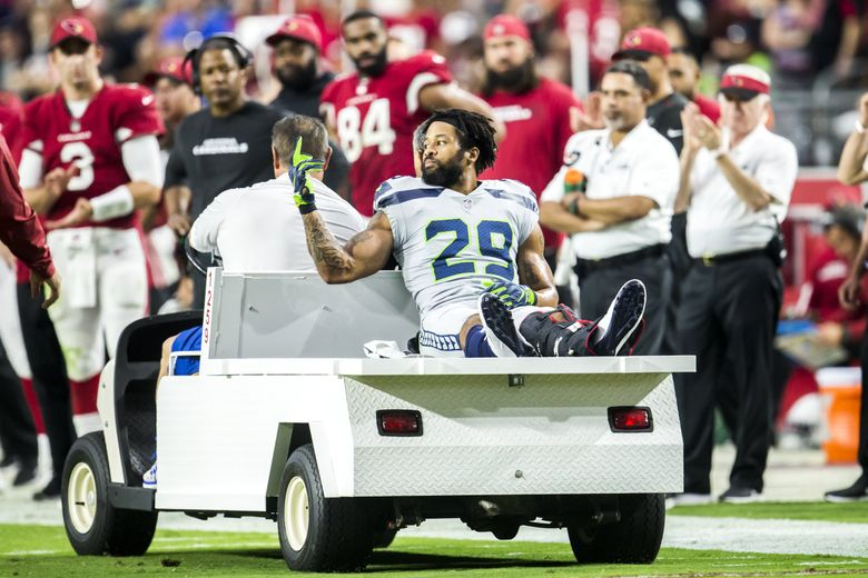 Seahawks defensive back Earl Thomas gestures to the Seahawks bench after he went down with a leg injury in the second half of a game against the Arizona Cardinals in September. (Bettina Hansen / The Seattle Times)