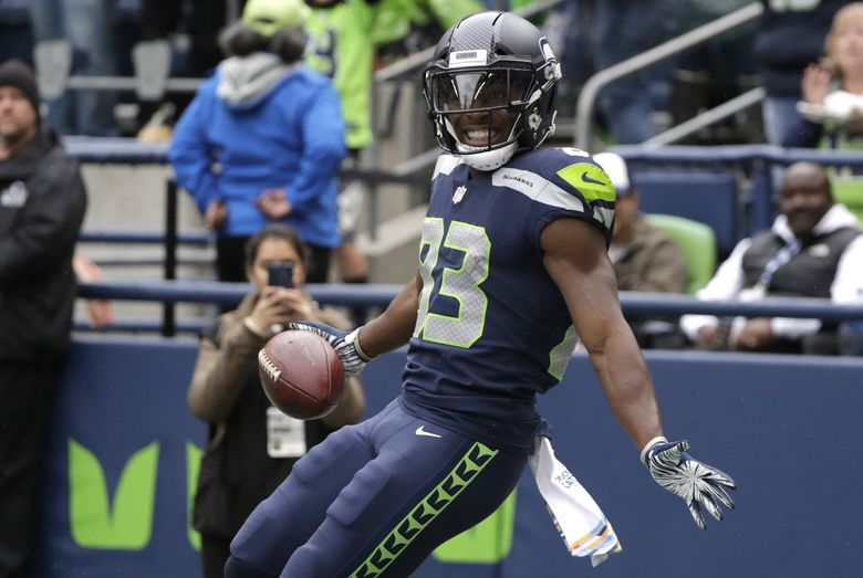 Seattle Seahawks wide receiver David Moore celebrates after he made a catch for his second touchdown against the Los Angeles Rams during the second half of an NFL football game, Sunday, Oct. 7, 2018, in Seattle.  (Elaine Thompson / The Associated Press)