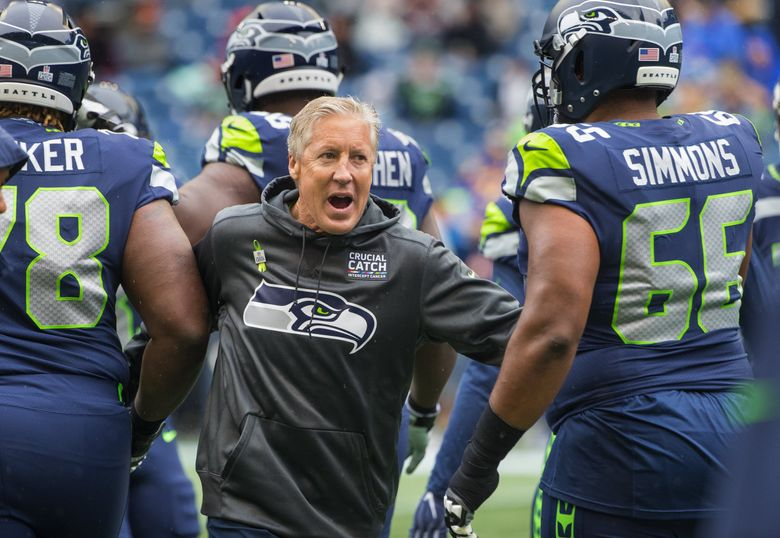 Seattle Seahawks head coach Pete Carroll welcomes the team onto the field as the Seattle Seahawks play the Los Angeles Rams at CenturyLink Field in Seattle on October 7, 2018. (Mike Siegel / The Seattle Times)
