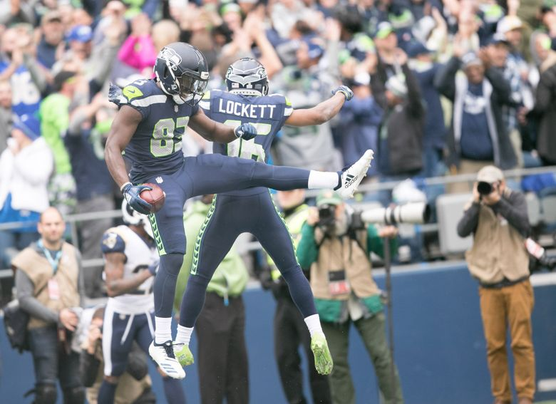 David Moore celebrates his touchdown with Tyler Lockett as the Seahawks take on the Rams at CenturyLink Field on Sunday, October 7.(Rebekah Welch / The Seattle Times)