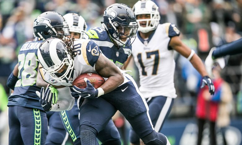 Todd Gurley II pushes past Seahawks defenders to score a touchdown in the third quarter as the Seahawks take on the Rams at CenturyLink Field on Sunday, October 7.  (Rebekah Welch / The Seattle Times)