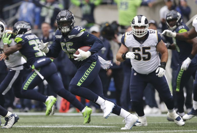 Seattle Seahawks defensive end Frank Clark (55) runs the ball after he intercepted a pass during the first half of an NFL football game against the Los Angeles Rams, Sunday, Oct. 7, 2018, in Seattle. (AP Photo/Scott Eklund) SEA108 SEA108 (Scott Eklund / The Associated Press)