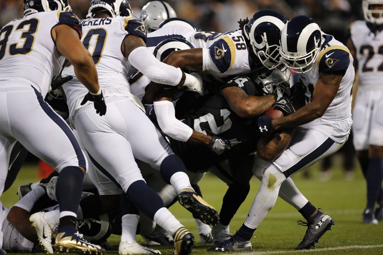 Oakland Raiders running back Marshawn Lynch carries the ball into the end zone for a touchdown as Los Angeles Rams linebacker Cory Littleton (58) tries to stop him during the first half of an NFL football game against the Los Angeles Rams in Oakland, Calif., Monday, Sept. 10, 2018. (AP Photo/John Hefti)  (John Hefti / AP)