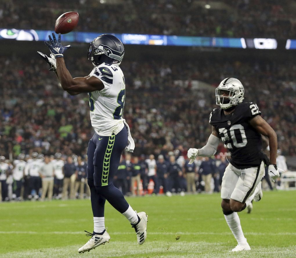 David Moore (83) catches one of the four TDs he's hauled in over the last three games. (AP Photo/Tim Ireland)
