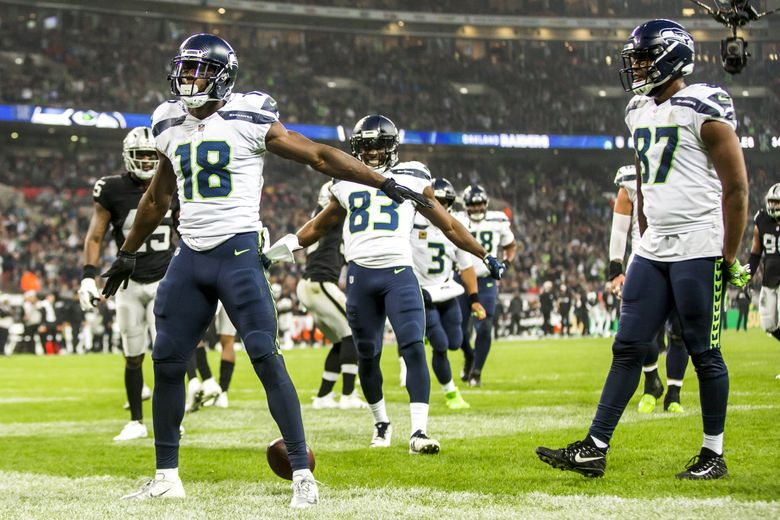 Seahawks wide receiver Jaron Brown celebrates his touchdown against the Oakland Raiders in 2018 at Wembley Stadium in London. Under proposed changes, more NFL games could be played internationally. (Bettina Hansen / The Seattle Times)