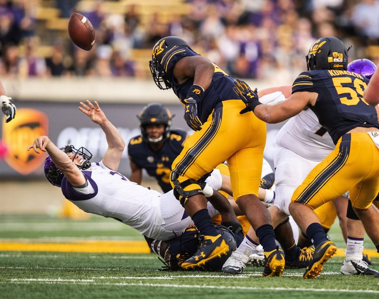 Jake Browning throws the ball away and is called for intentional grounding in the third quarter last Saturday against Cal in Berkeley, Calif. (Dean Rutz / The Seattle Times)