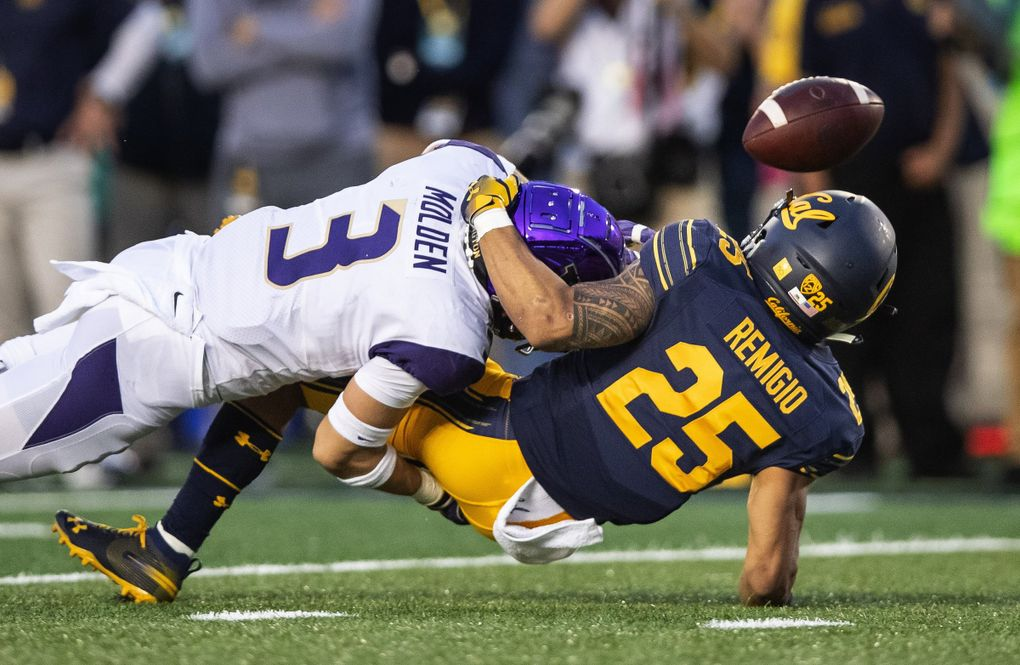 On 3rd and 5 from the Bear 11-yard line, Washington's Elijah Molden lays a hit on Cal receiver Nikko Remigio that dislodges the ball, and forces a punt with 11:45 to play in the game. (Dean Rutz / The Seattle Times)