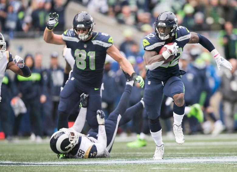 Chris Carson pushes down the field during the Seahawks' 33-31 loss to the Rams at CenturyLink Field. (Rebekah Welch / The Seattle Times)