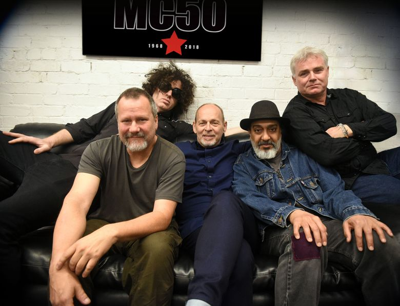 """Soundgarden's Kim Thayil (second from right) joined a reassembled version of MC5, led by founding guitarist Wayne Kramer (center), to celebrate the 50th anniversary of the Detroit proto-punks' """"Kick Out the Jams"""" album. The other members are: Billy Gould (front left), Marcus Durant (back left) and Brendan Canty (right). Billed as MC50, the band plays the Showbox on Oct. 16. (Photo by Chris McKay)"""