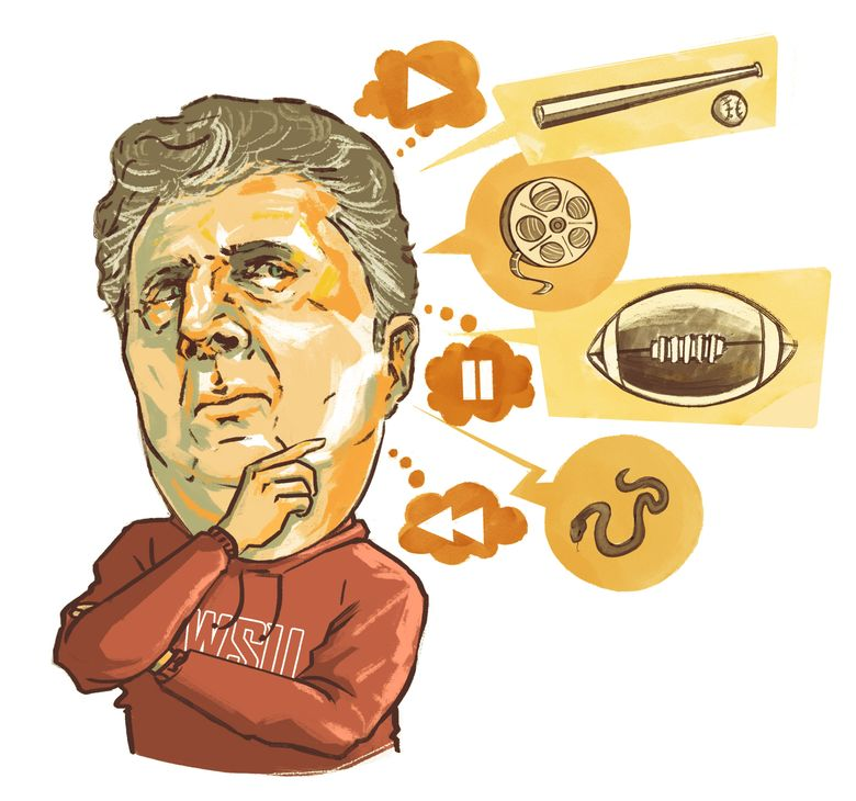 Washington State football coach Mike Leach's film sessions can quickly bounce between serious football discussions and lighter topics — baseball, movies, TV shows or, oddly enough, snakes. (Jennifer Luxton / The Seattle Times)