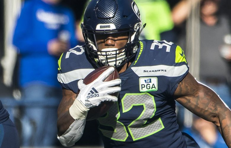 Seahawks running back Chris Carson rushes for 15 yards and a first down in the first quarter as the Seattle Seahawks take on the Los Angeles Chargers at CenturyLink Field in Seattle Sunday November 4, 2018. 208372 (Bettina Hansen / The Seattle Times)