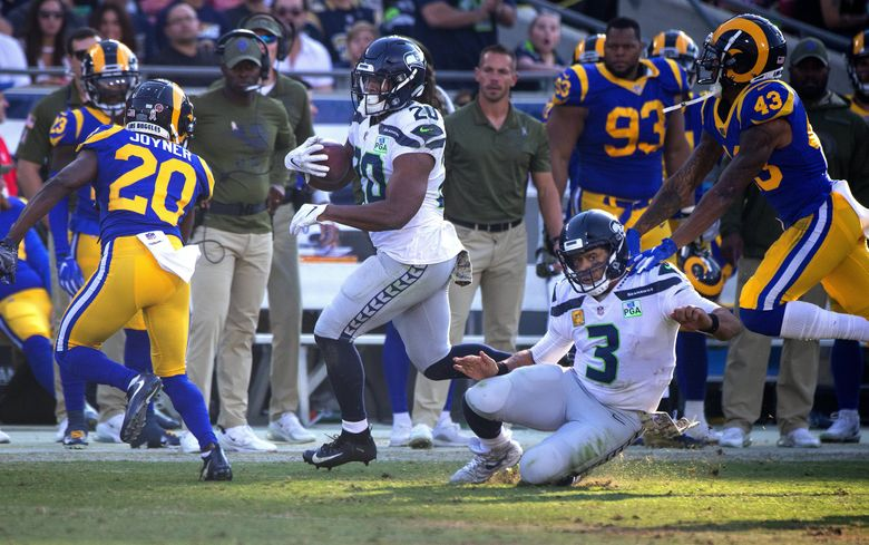 Seattle Seahawks quarterback Russell Wilson (3) blocks for Seattle Seahawks running back Rashaad Penny (20) during 3rd quarter action as the Los Angeles Rams play the Seattle Seahawks at the Los Angeles Coliseum in Los Angeles CA, on November 11, 2018. (Mike Siegel / The Seattle Times)