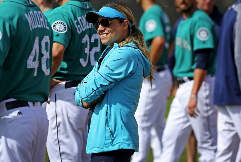Mariners director of high performance Lorena Martin talks with the pitching staff at spring training in February in Peoria, Arizona.  (Ken Lambert / The Seattle Times)