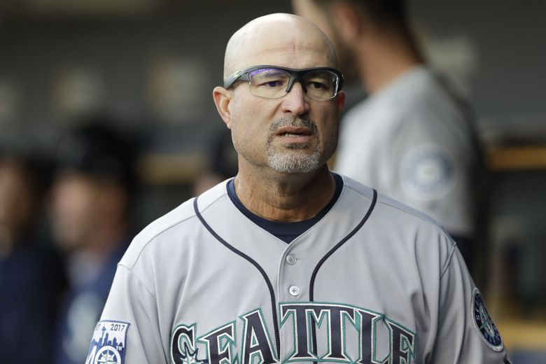 Seattle Mariners third base coach Manny Acta is seen in the dugout during the first inning of a baseball game against the Detroit Tigers, Tuesday, April 25,2017, in Detroit. (AP Photo/Carlos Osorio) otkco110 otkco110 (Carlos Osorio / The Associated Press)