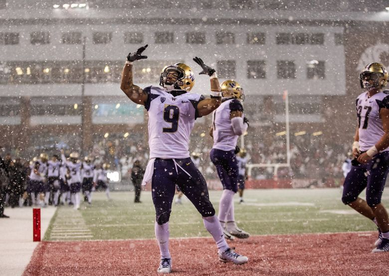 Myles Gaskin celebrates his second-quarter touchdown against Washington State in the 2018 Apple Cup game November 23, 2018, at Martin Stadium in Pullman. (Dean Rutz / The Seattle Times)