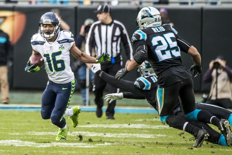 Seahawks wide receiver Tyler Lockett picks up 13 yards in the fourth quarter as the Seattle Seahawks take on the Carolina Panthers at Bank of America Stadium in Charlotte, North Carolina Sunday November 25, 2018. (Bettina Hansen / The Seattle Times)