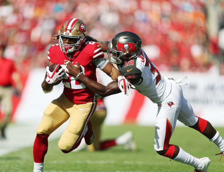 San Francisco 49ers running back Matt Breida (22) runs the ball for a large gain while trying to avoid the tackle by Tampa Bay Buccaneers free safety Isaiah Johnson (39) during the second quarter on Sunday, Nov. 25, 2018 at Raymond James Stadium in Tampa, Fla. (Monica Herndon/Tampa Bay Times/TNS) 1247597 1247597 (Monica Herndon / TNS)