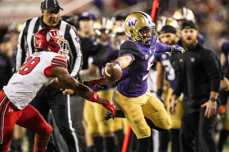 Washington's Andre Baccellia reaches out for the first-down marker, but doesn't get it, forcing Washington to kick a field goal that was blocked in the fourth quarter.  (Dean Rutz / The Seattle Times)