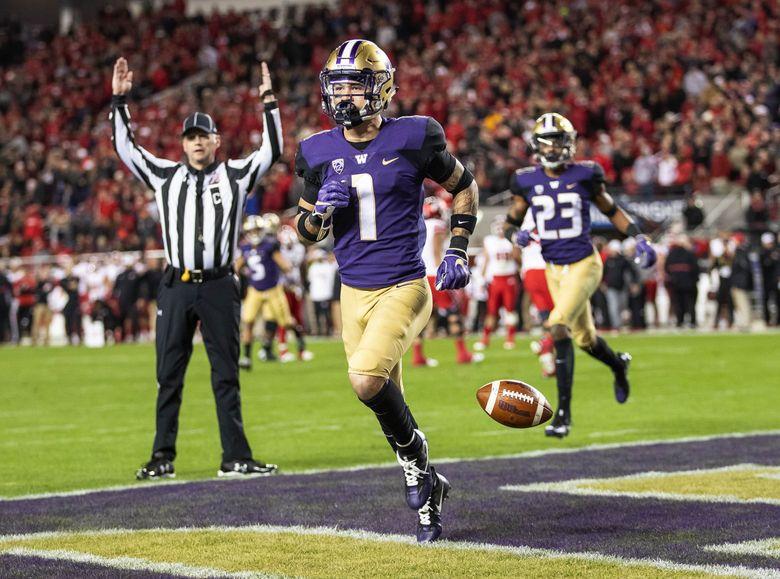 Byron Murphy returns the interception 66-yards for a touchdown in the 3rd quarter against Utah. (Dean Rutz / The Seattle Times)