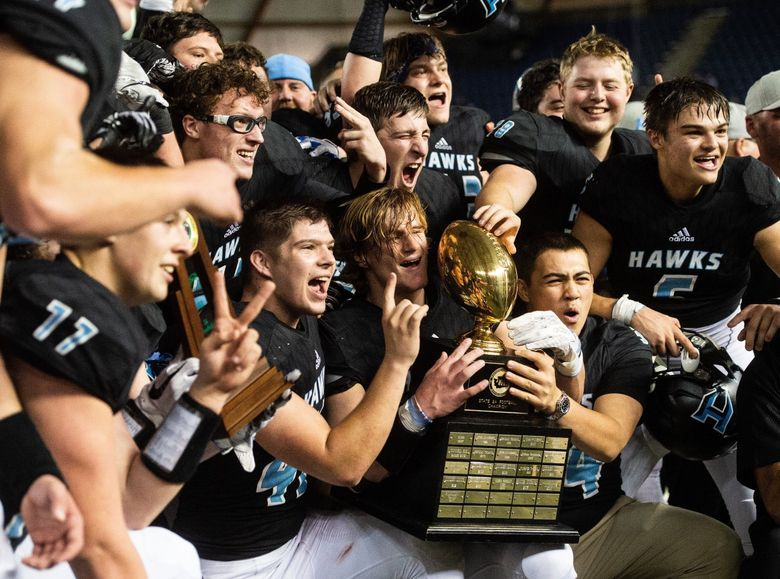 Hockinson players celebrate their win against Lynden. Hockinson played Lynden in the WIAA 2A football state championship game at the Tacoma Dome in Tacoma, Wash., on Saturday, Dec. 1, 2018.   (Joshua Bessex / The Tacoma News Tribune)