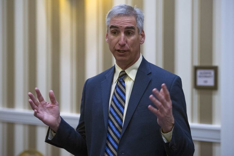In this Jan. 16, 2015, file photo, Oliver Luck speaks with members of the media at the NCAA Convention in Oxon, Md. Former NFL quarterback Oliver Luck is leaving his high-ranking position at the NCAA to become commissioner of the XFL, the second edition of professional wrestling mogul Vince McMahon's football league (Cliff Owen / AP)