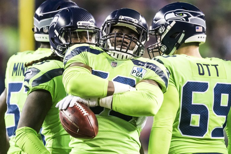 SEAHAWKS FILE —  Seahawks linebacker Jacob Martin strikes a pose after a punt return as the Seattle Seahawks take on the Minnesota Vikings for Monday Night Football at CenturyLink Field in Seattle Monday December 10, 2018. 208686 (Bettina Hansen / The Seattle Times)