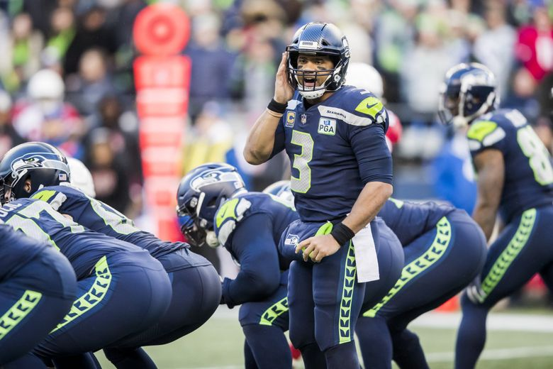Russell Wilson in a game in December 2018.  (Bettina Hansen / The Seattle Times)